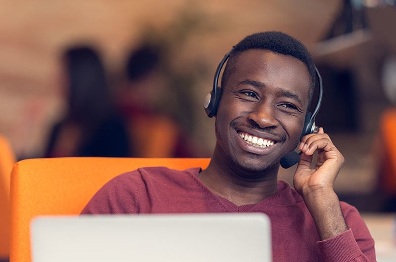 Man with headphones smiling.